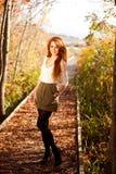 Mulher bonita no outono Fotos de Stock Royalty Free