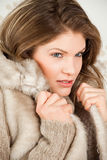 Mulher bonita no revestimento do inverno Fotografia de Stock Royalty Free
