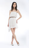 A mulher bonita no vestido branco isolou - o tiro do estúdio Fotos de Stock