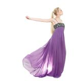 Mulher bonita no vestido roxo longo Fotografia de Stock Royalty Free