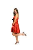 Mulher bonita no vestido vermelho isolado no branco Fotografia de Stock Royalty Free