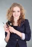 A mulher bonita nova com compo escovas Imagem de Stock Royalty Free