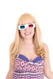 Mulher bonita nova com os vidros 3d, isolados sobre Fotografia de Stock Royalty Free
