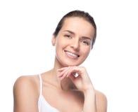 A mulher bonita nova demonstra sua pele perfeita foto de stock