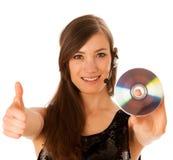 Mulher bonita nova DJ com o CD em sua mão Fotografia de Stock Royalty Free