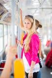 Mulher bonita, nova em um eléctrico/tramway Imagem de Stock