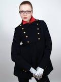 Mulher bonita nova em um revestimento curto preto Imagens de Stock Royalty Free