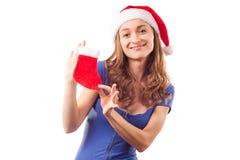 Mulher bonita nova nas mãos de uma bota do ` s do ano novo de um ano novo Imagem de Stock Royalty Free
