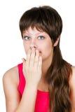Mulher bonita nova que cobre sua boca com sua mão. isolado Imagem de Stock Royalty Free