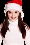 Mulher bonita que desgasta o chapéu de Santa fotografia de stock royalty free