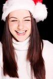 Mulher bonita que desgasta o chapéu de Santa fotos de stock royalty free