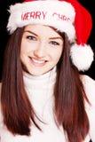 Mulher bonita que desgasta o chapéu de Santa imagem de stock royalty free