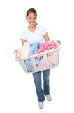 Mulher bonita que faz a lavanderia Foto de Stock