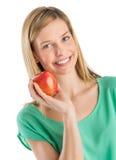 Mulher bonita que guardara Apple imagem de stock