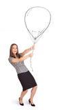 Mulher bonita que guardara o desenho do balão imagem de stock royalty free