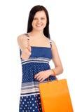 Mulher bonita que guardara o saco de compras Imagens de Stock Royalty Free