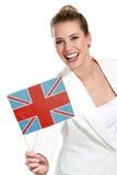 Mulher bonita que mostra bandeiras internacionais Fotografia de Stock Royalty Free