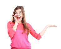 Mulher bonita que olha o produto com alegria Fotografia de Stock Royalty Free