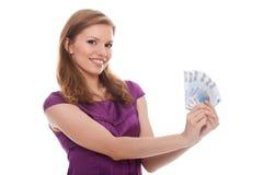 Mulher bonita que prende o euro- dinheiro Foto de Stock Royalty Free
