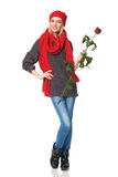 A mulher bonita que prende o vermelho levantou-se Fotografia de Stock Royalty Free
