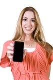 Mulher bonita que prende um telefone de pilha fotografia de stock royalty free