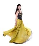 Mulher bonita que twirling em seu vestido Imagem de Stock