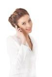 Mulher bonita que usa um telemóvel Foto de Stock Royalty Free