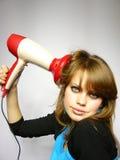 A mulher bonita seca o cabelo o secador de cabelo Imagens de Stock