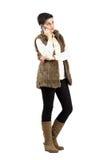 Mulher calma bonito no telefone celular que olha afastado Fotos de Stock Royalty Free