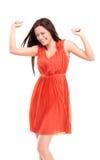 A mulher caucasiano feliz com mãos levantou a comemoração de sua vitória imagens de stock royalty free