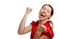 Mulher Cheering com cabelo vermelho Foto de Stock