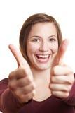 Mulher Cheering que prende ambos os polegares Imagem de Stock