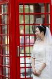Mulher chinesa asiática no vestido de casamento Fotografia de Stock Royalty Free