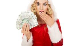 Mulher chocada de Santa que guarda um grampo do dinheiro polonês Fotos de Stock