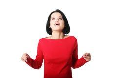 Mulher chocada e entusiasmado que olha acima foto de stock