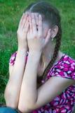 A mulher cobriu sua face Imagens de Stock