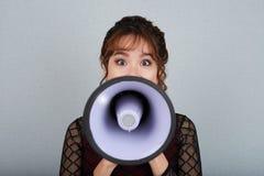 Mulher com altifalante Foto de Stock Royalty Free