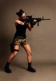 Mulher com arma. Fotografia de Stock Royalty Free