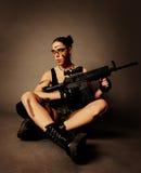 Mulher com arma. Foto de Stock