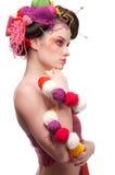 Mulher com arte da face da cor no estilo de confecção de malhas Fotografia de Stock Royalty Free