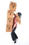 Mulher com as caixas de cartão prontas para cair imagens de stock