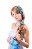 Mulher com as flores no cabelo Imagem de Stock