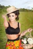 Mulher com as flores no campo Imagens de Stock Royalty Free