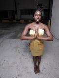 Mulher com as mãos clasped fotografia de stock royalty free