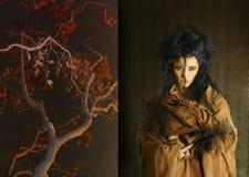 Mulher com as penas marrons da terra arrendada da veste Imagem de Stock Royalty Free