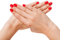 Mulher com as unhas vermelhas manicured bonitas Fotos de Stock Royalty Free