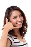 Mulher com atendimento nós sinal da mão Foto de Stock Royalty Free