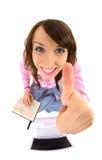 Mulher com atlas e portátil que mostra os polegares acima Imagem de Stock