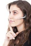 Mulher com auriculares Imagens de Stock