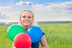 Mulher com balões Imagens de Stock Royalty Free